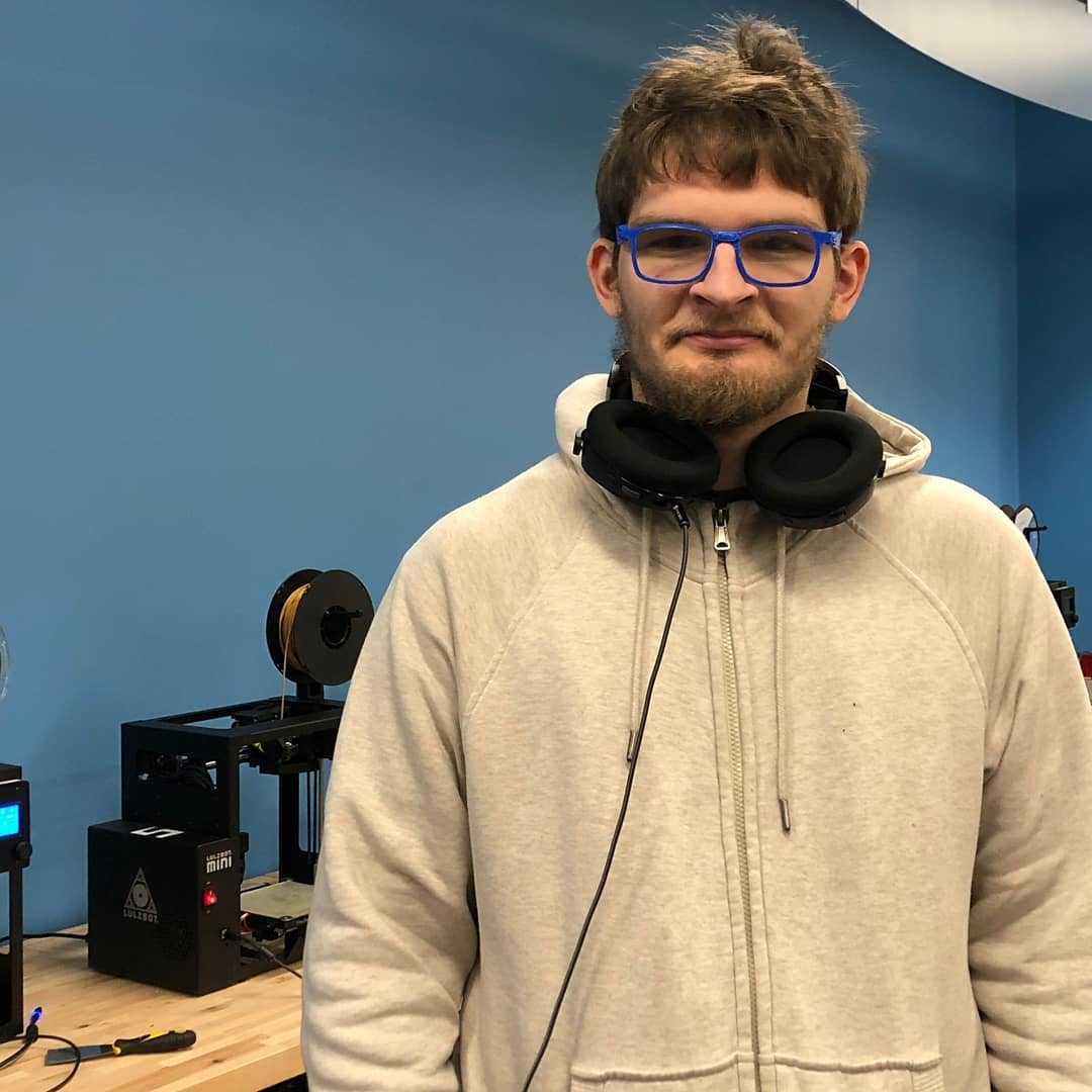 A student wearing blue 3D-printed glasses