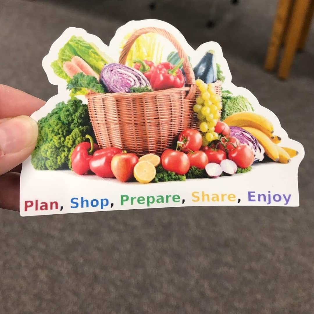 A sticker depicting a basket of vegetables and the words