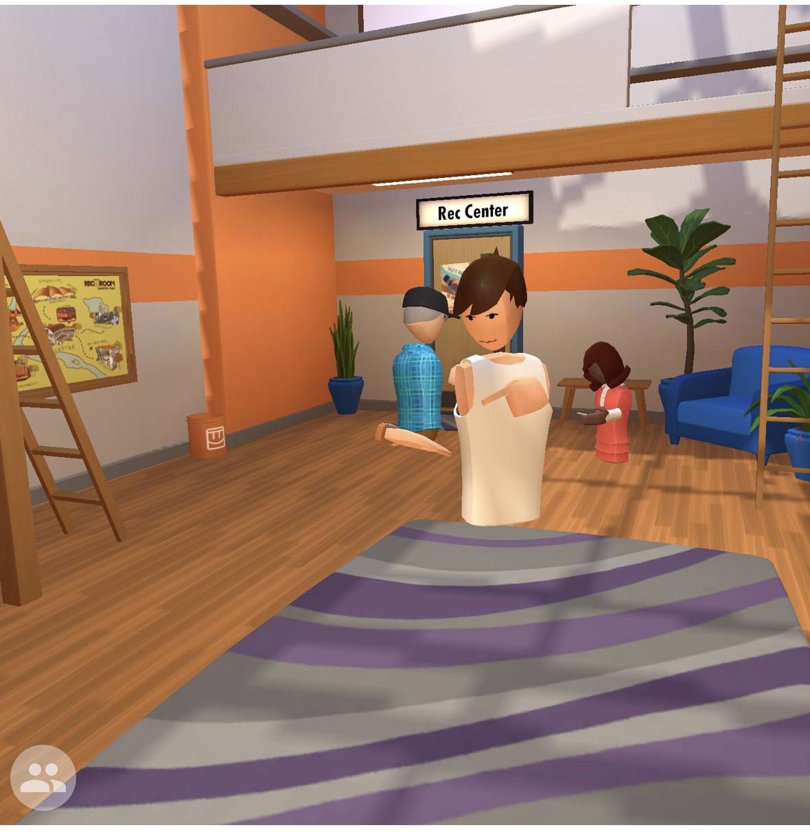 A screenshot from Rec Room, a VR software, showing three avatars