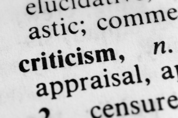 close-up on dictionary entry for the word criticism