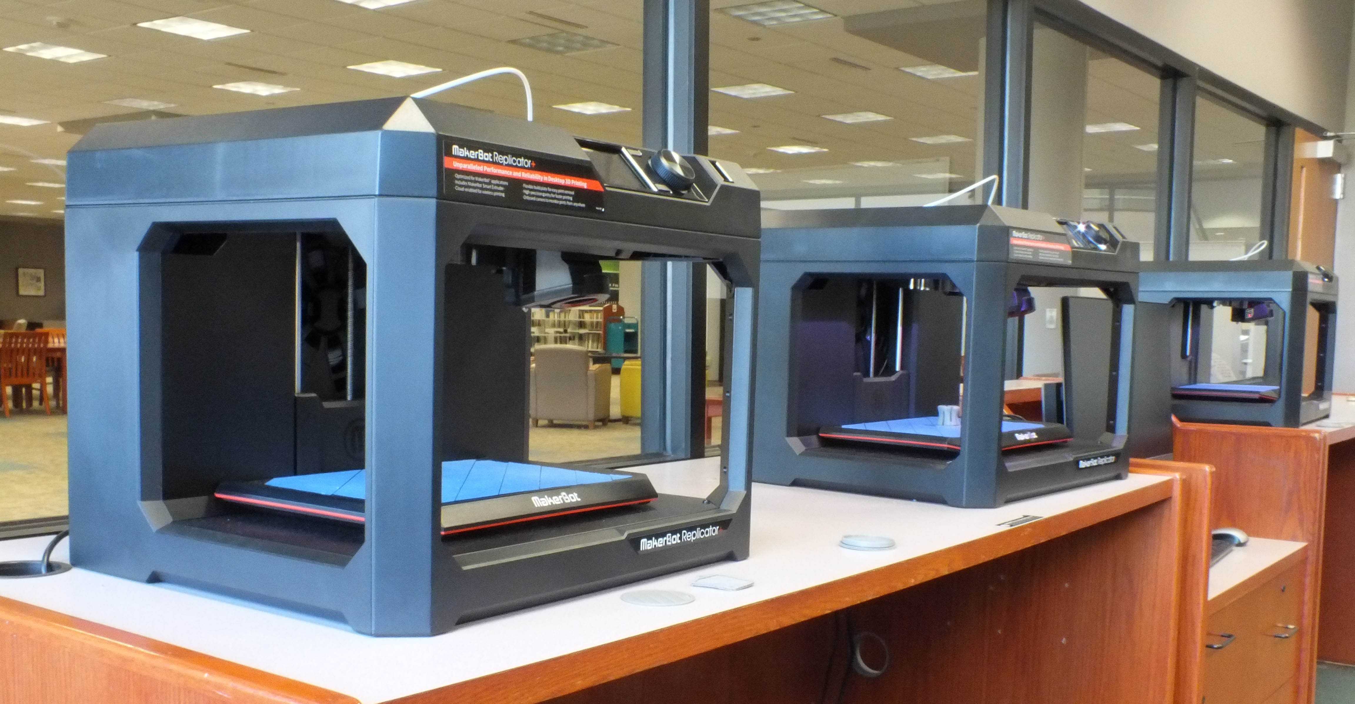 Three Makerbot Replicator+ 3D Printers
