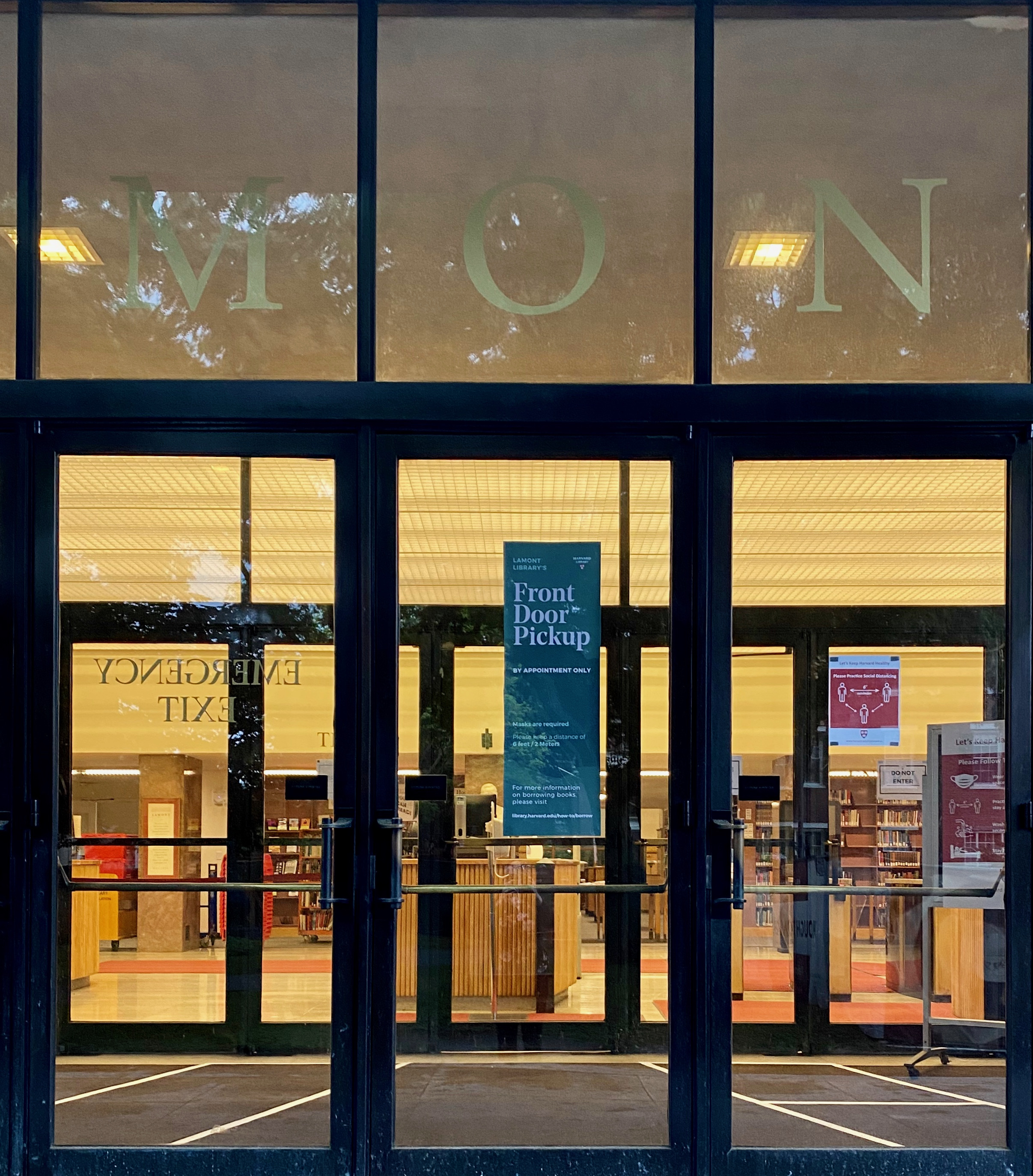 "Front doors of Lamont Library displaying a ""Front"