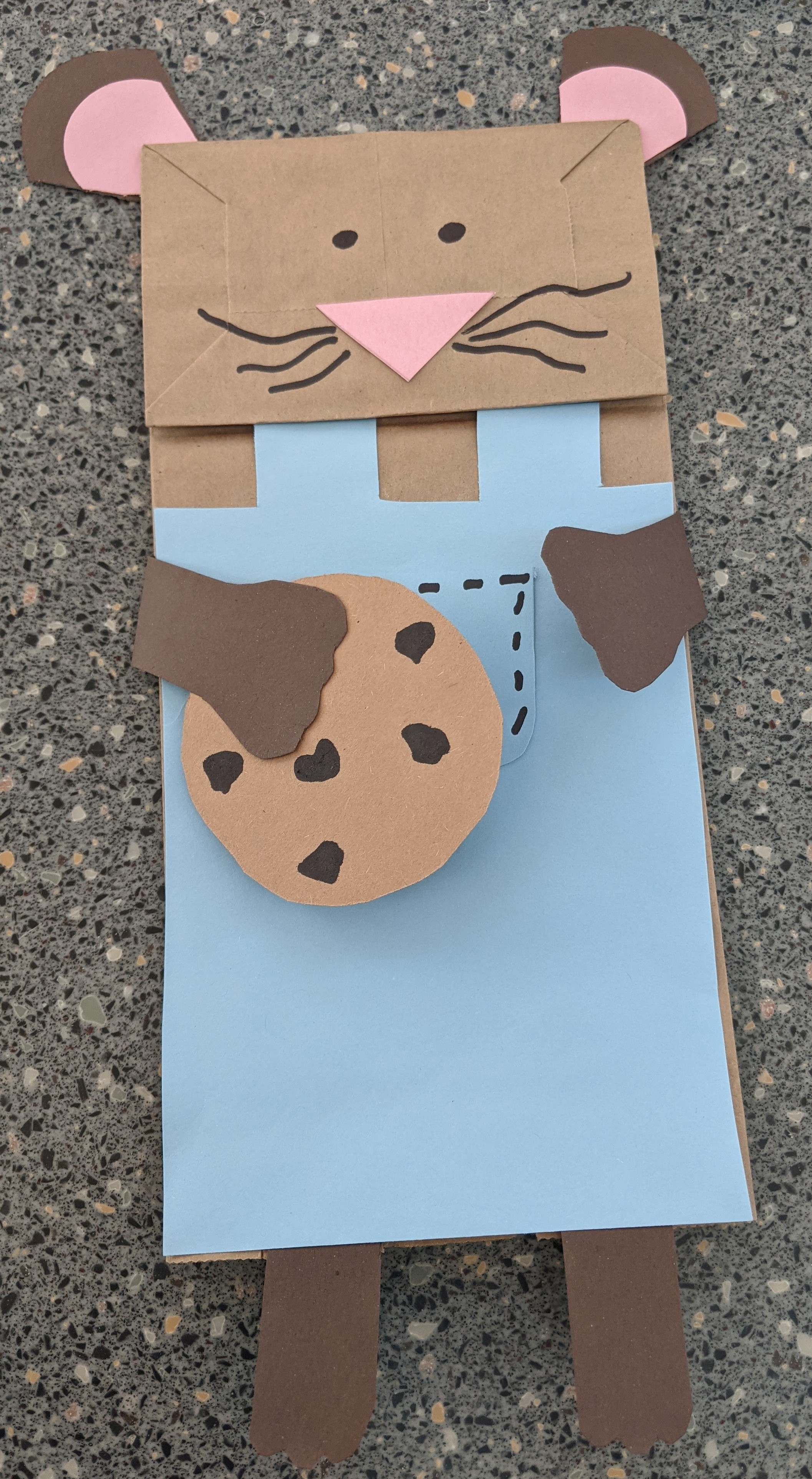 Image of child craft of a mouse made from paper bag and other supplies