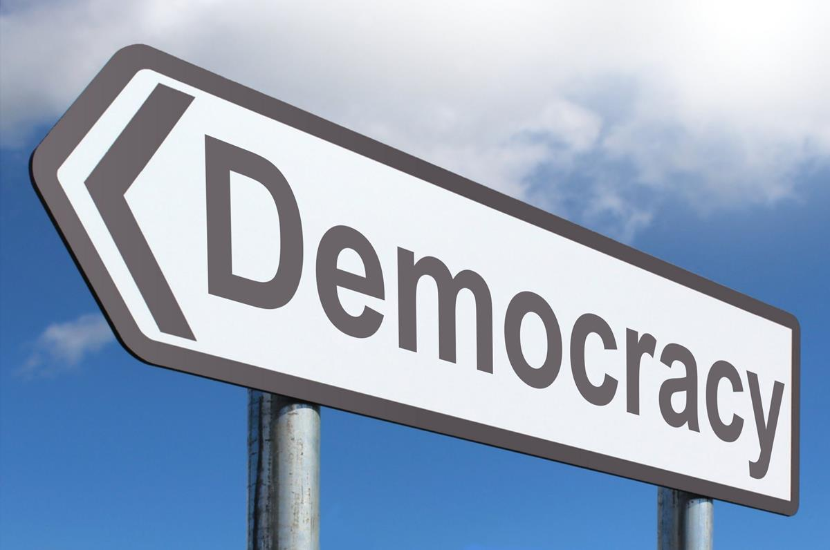 image of democracy road sign