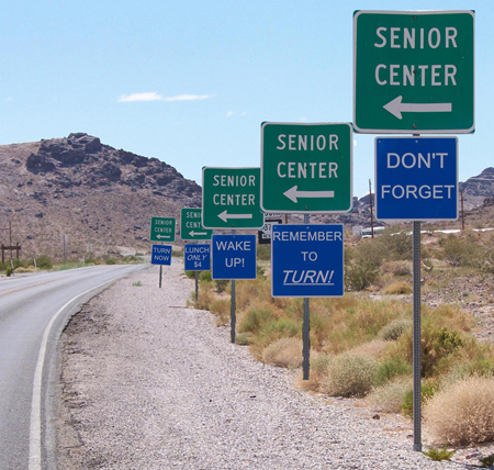 Road signs reminding seniors where to turn