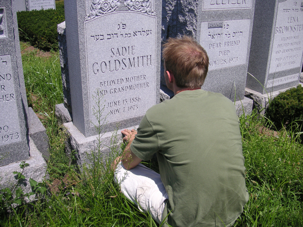 young white man in front of headstone