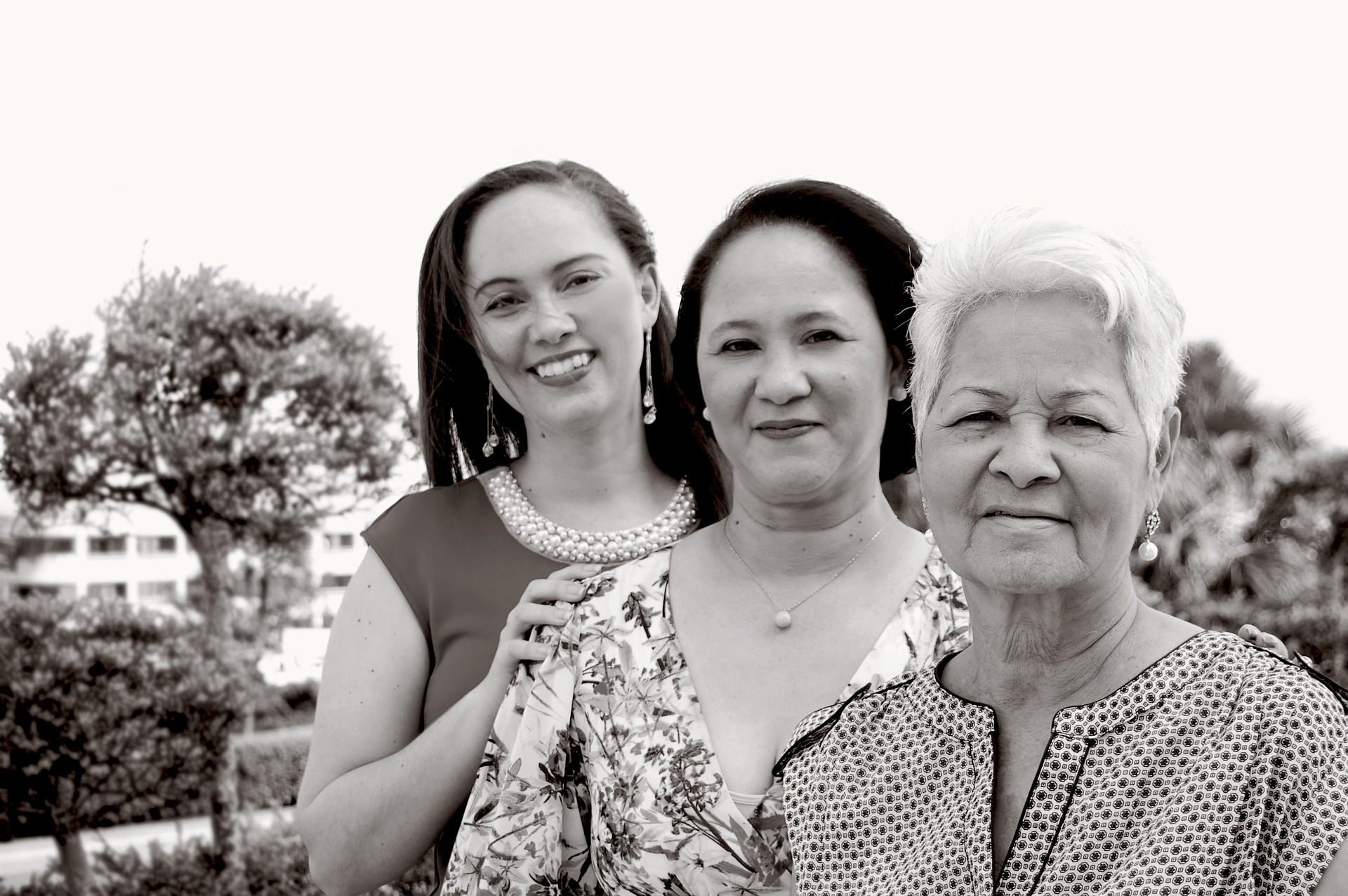 Black and white photograph of three generations of women of Asian or Latin American descent.