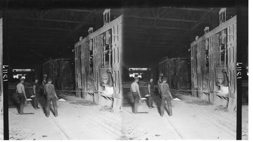 Photograph of men feeding open-hearth furnaces