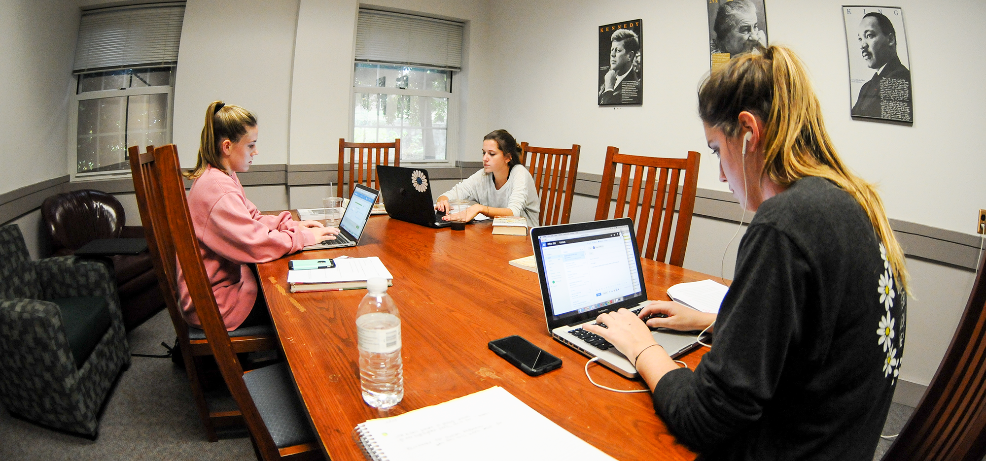 RC students studying in a group study room on the ground floor.