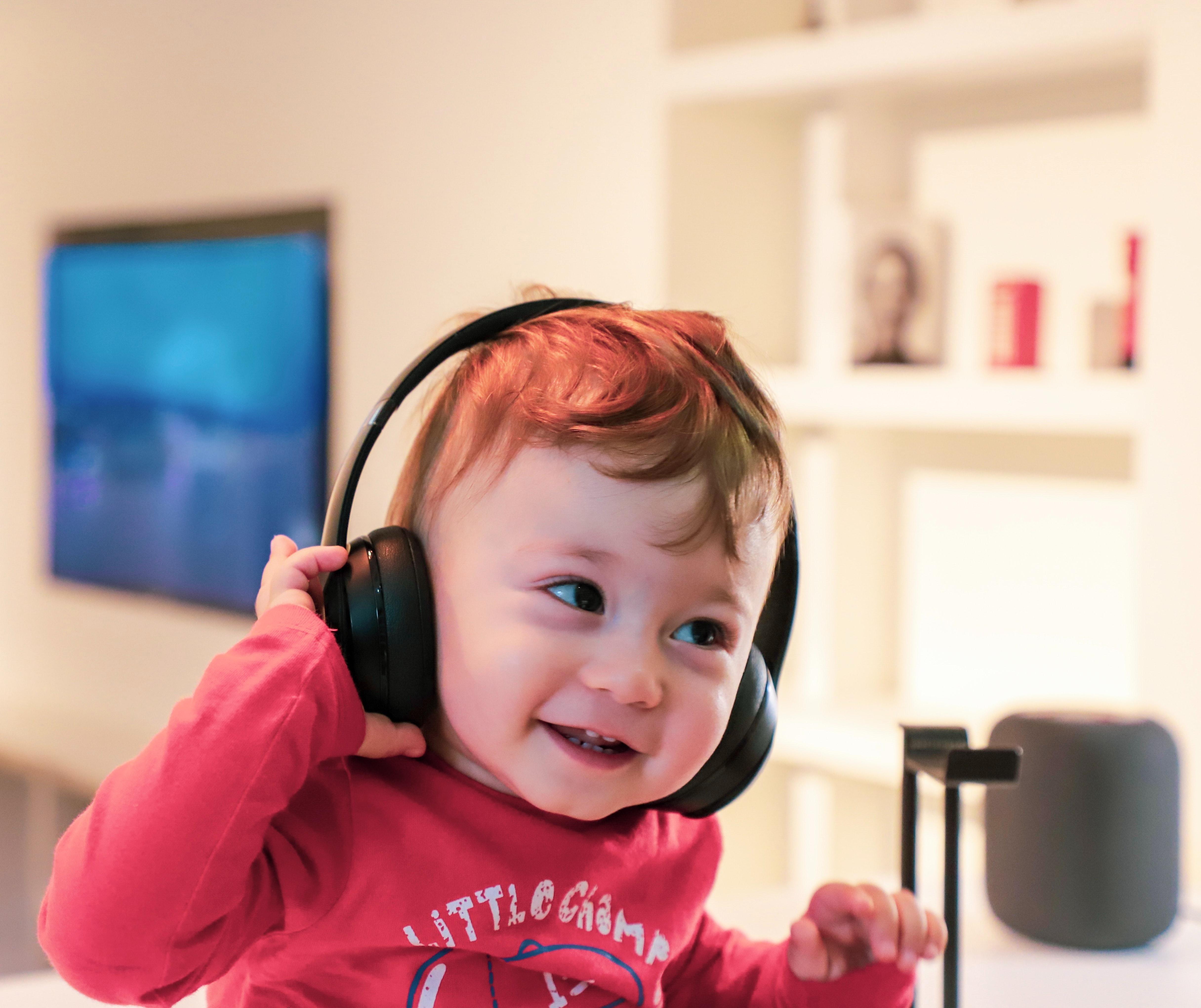 little smiling child in headphones