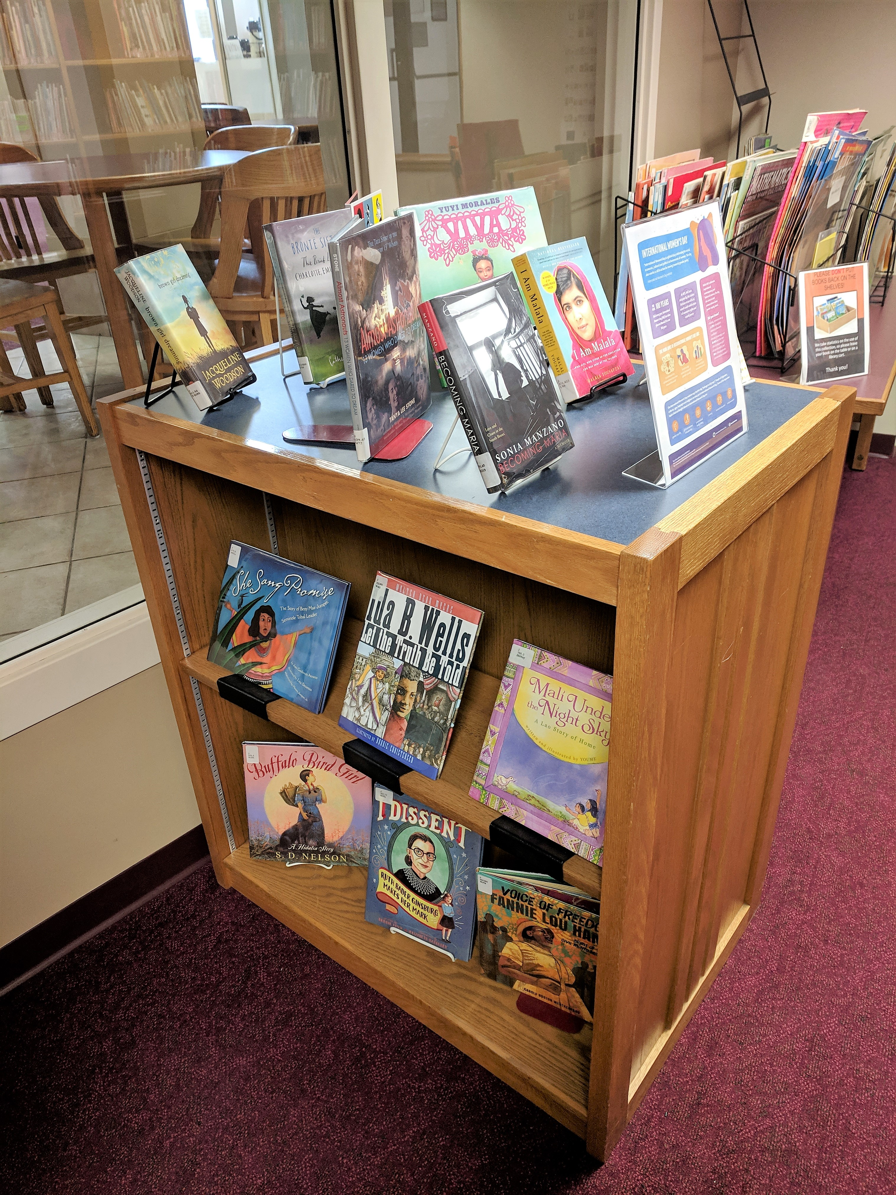 image is of International Women's Day book display at Vogel Library