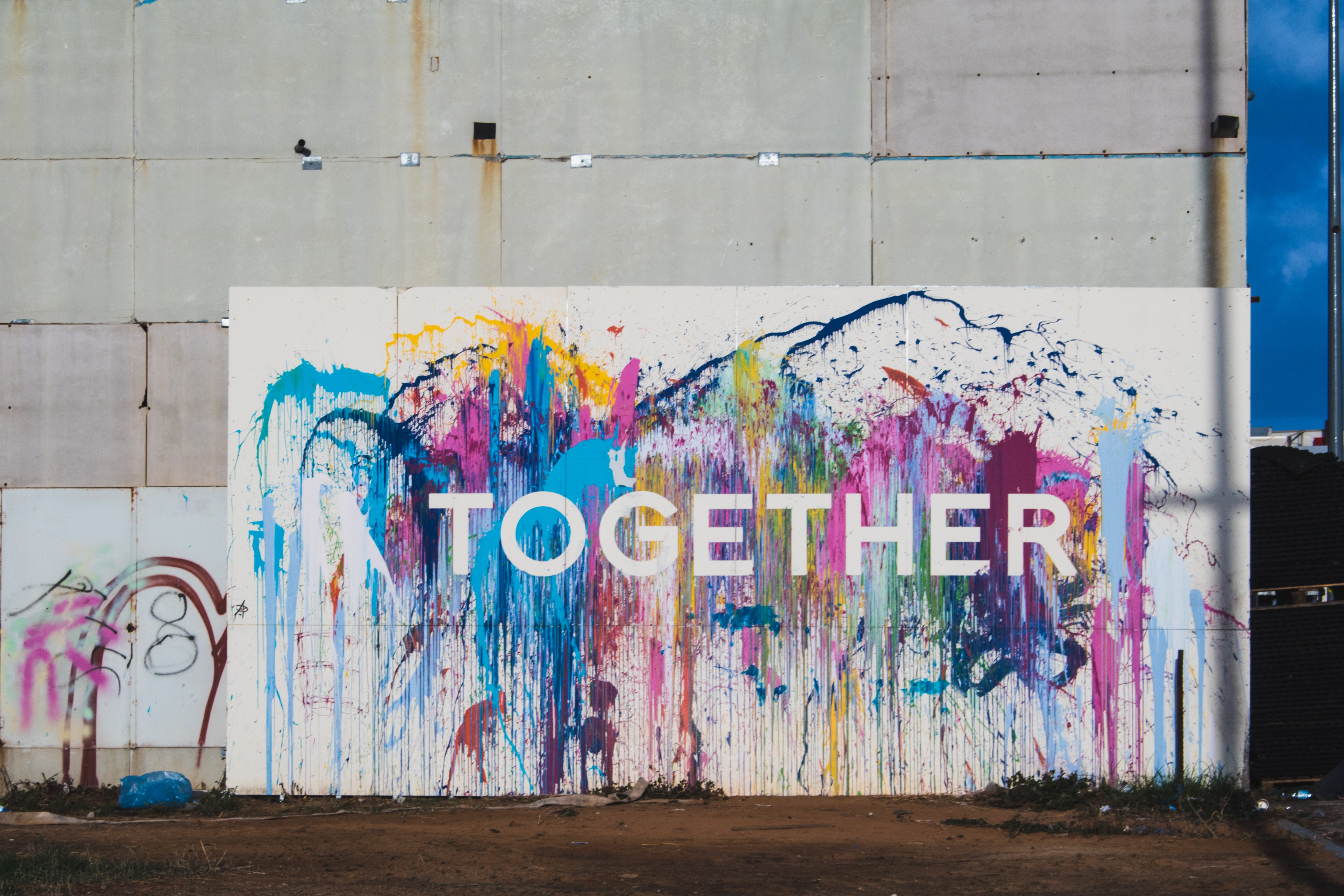 "image is of graffiti that says ""together"""