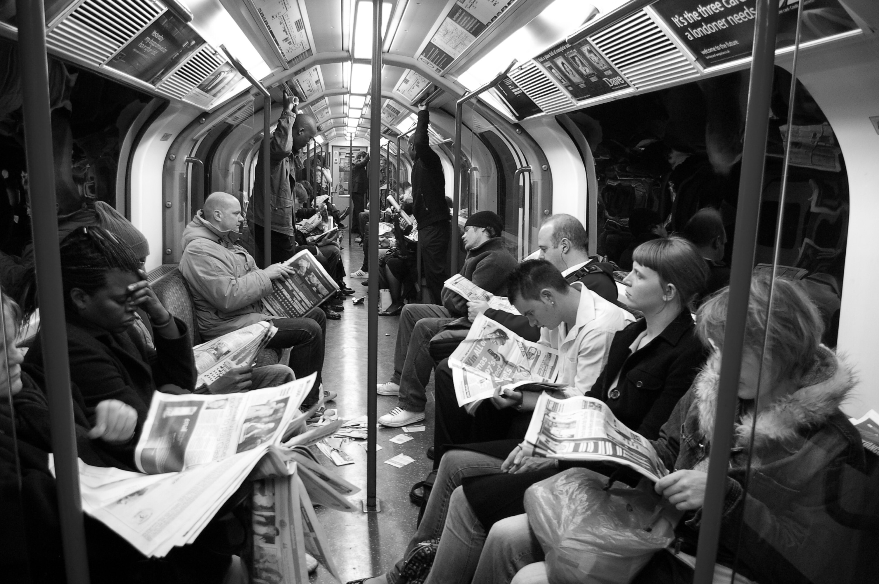 commuters reading on a subway