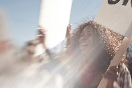 Black woman demonstrator.