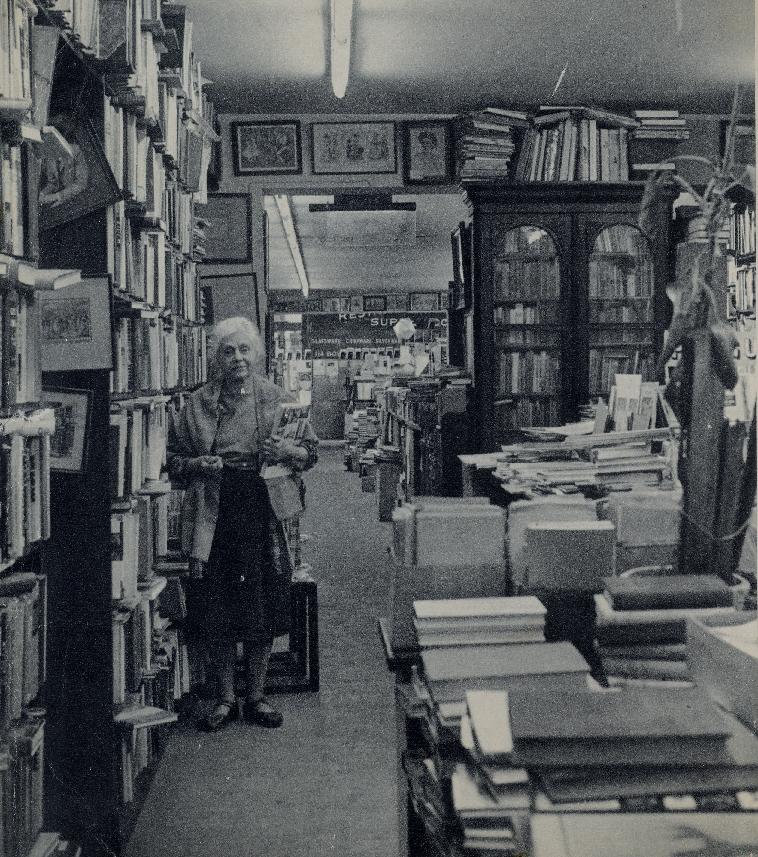 B&W photograph of Frances Steloff and the interior of the Gotham Book Mart. New York.