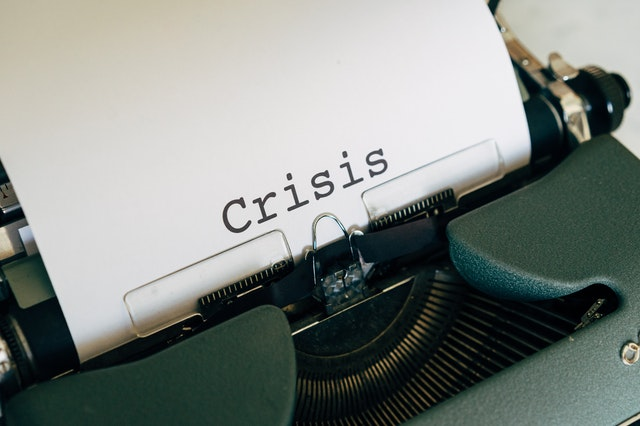 crisis written on a typewriter