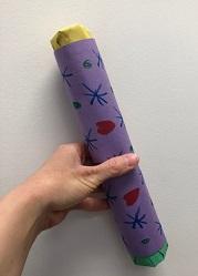 Image of a hand holding a rain stick.