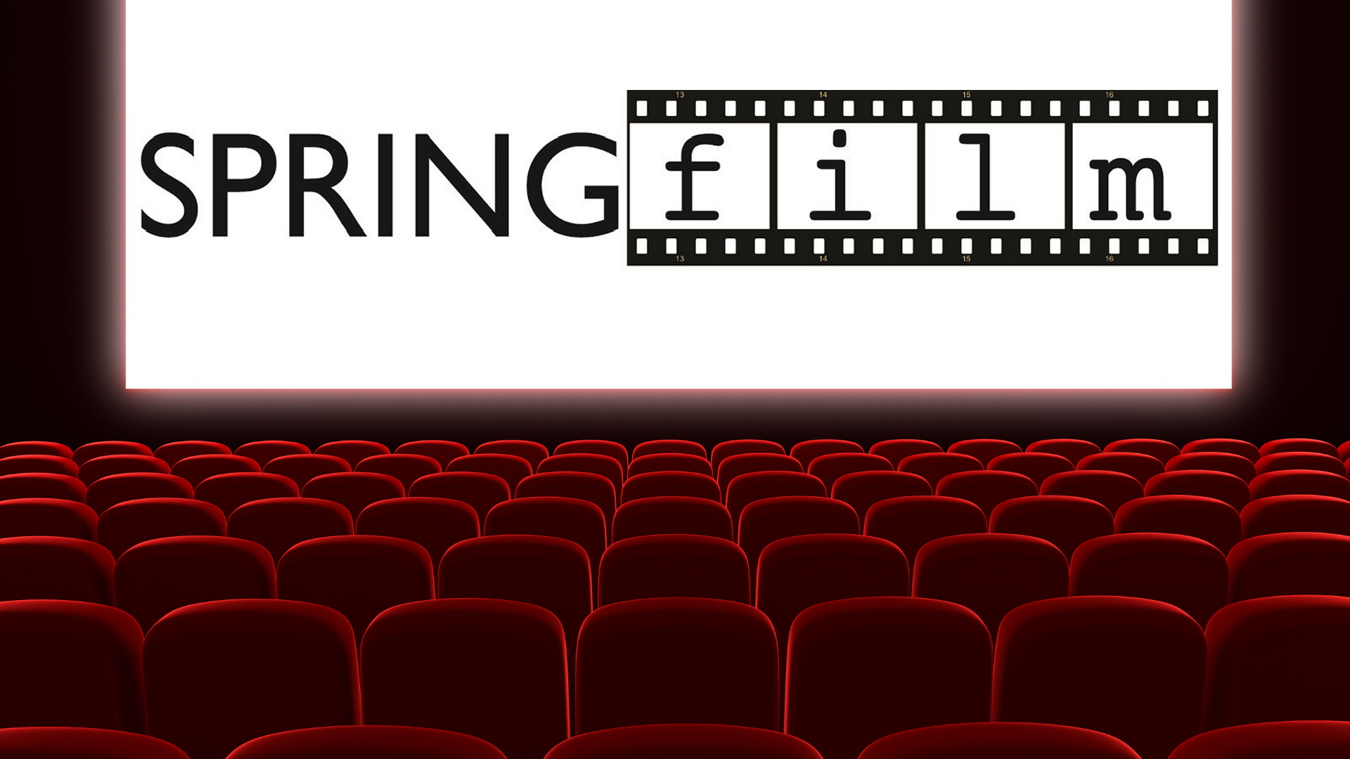 The interior of a movie theater with the word SpringFilm projected on the movie screen