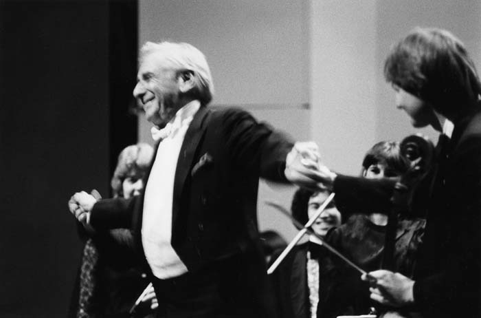 Conductor Leonard Bernstein with NCSA Orchestra after performing at R.L. Stevens Tribute (part of Stevens Center Opening)