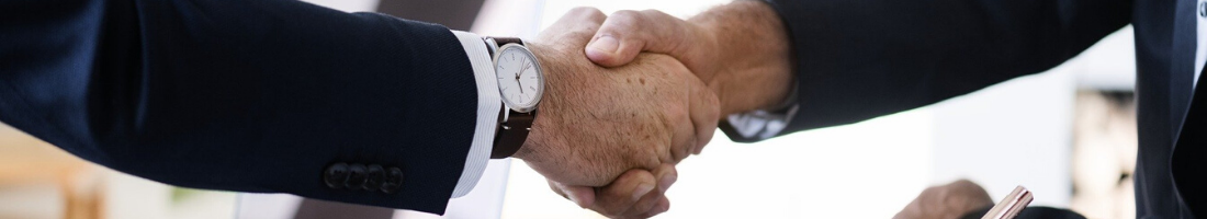 Picture of two men shaking hands