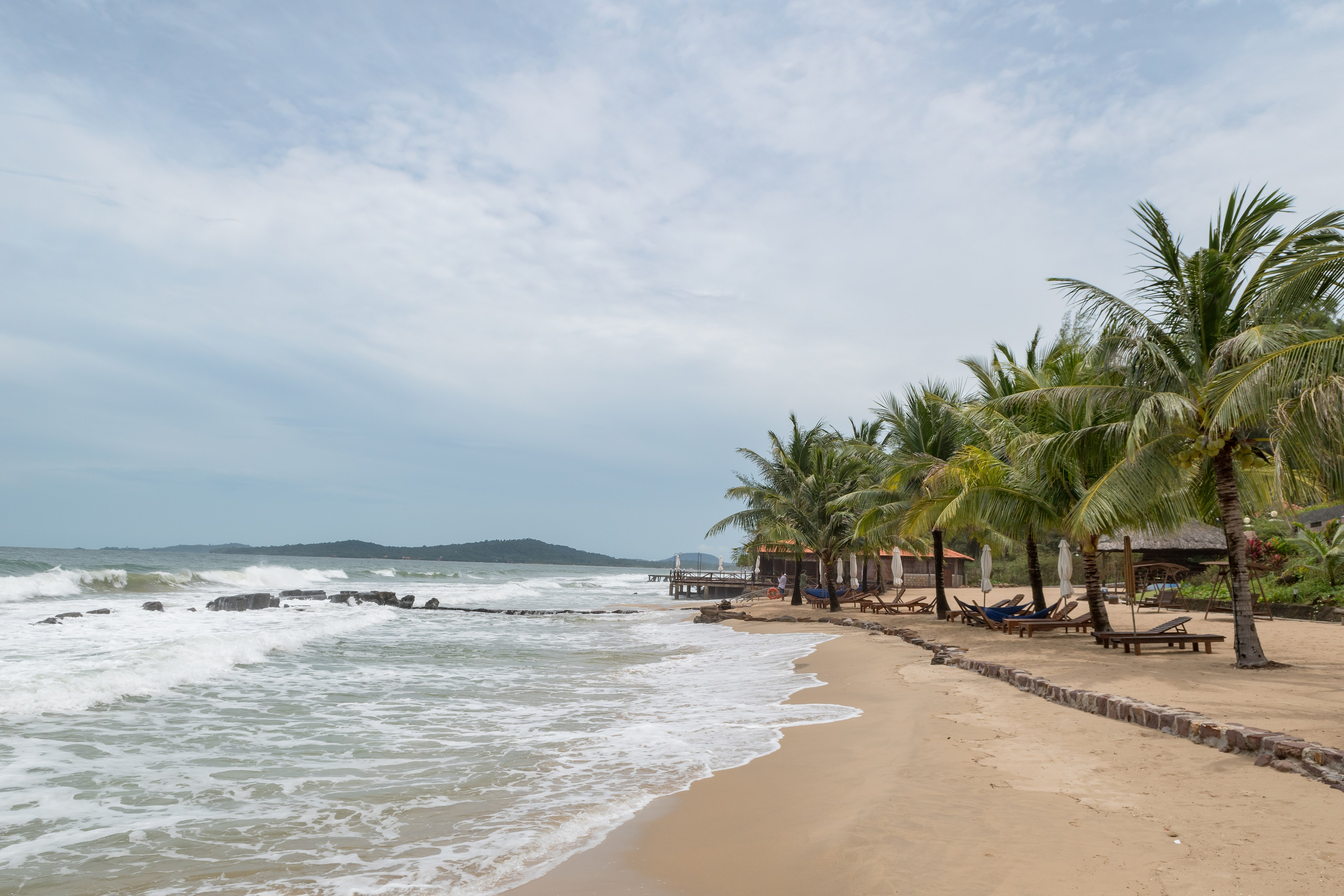Shore line with palm trees of a beach in Vietnam