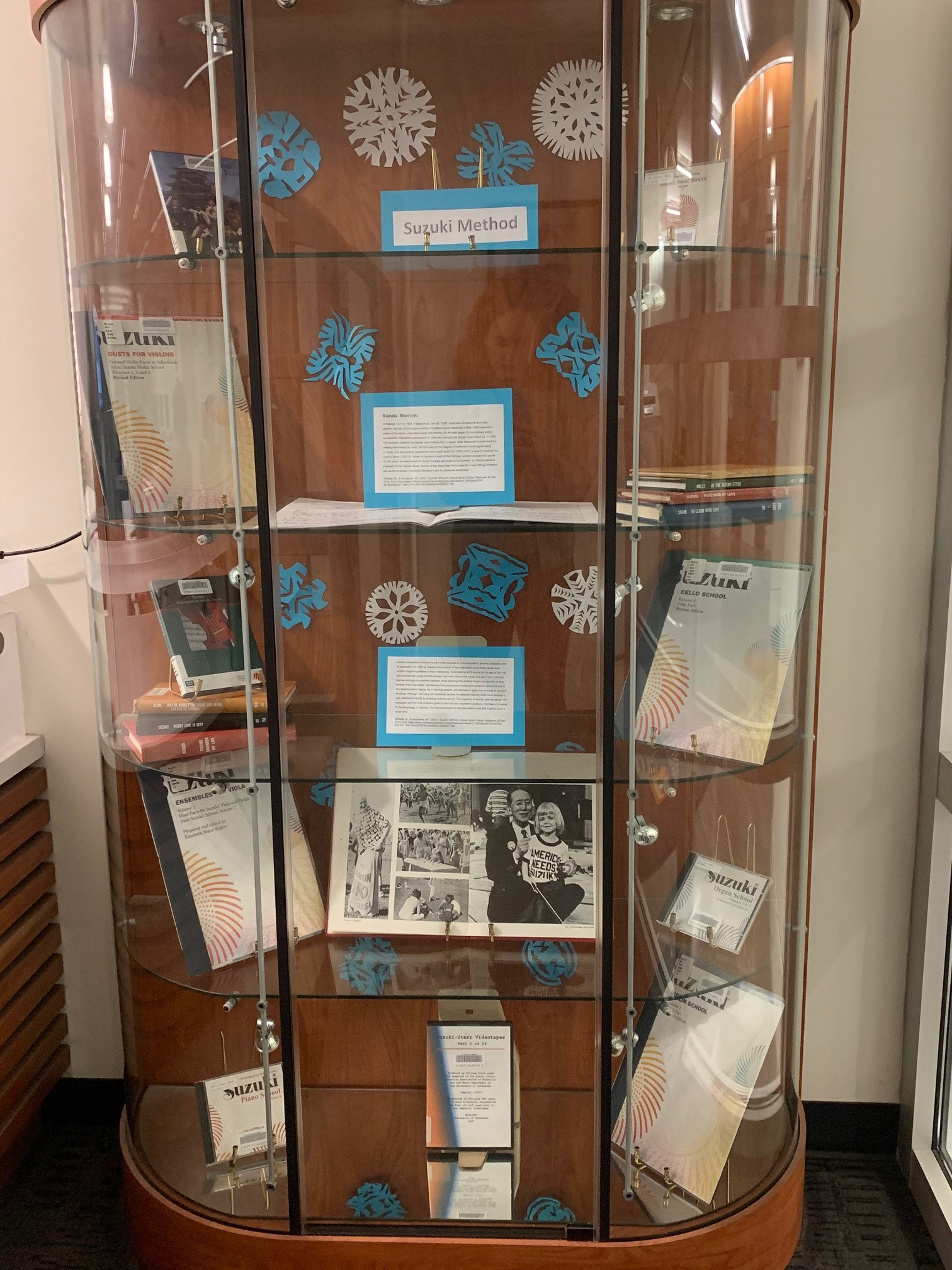 DeVine Display Case featuring Suzuki methods materials
