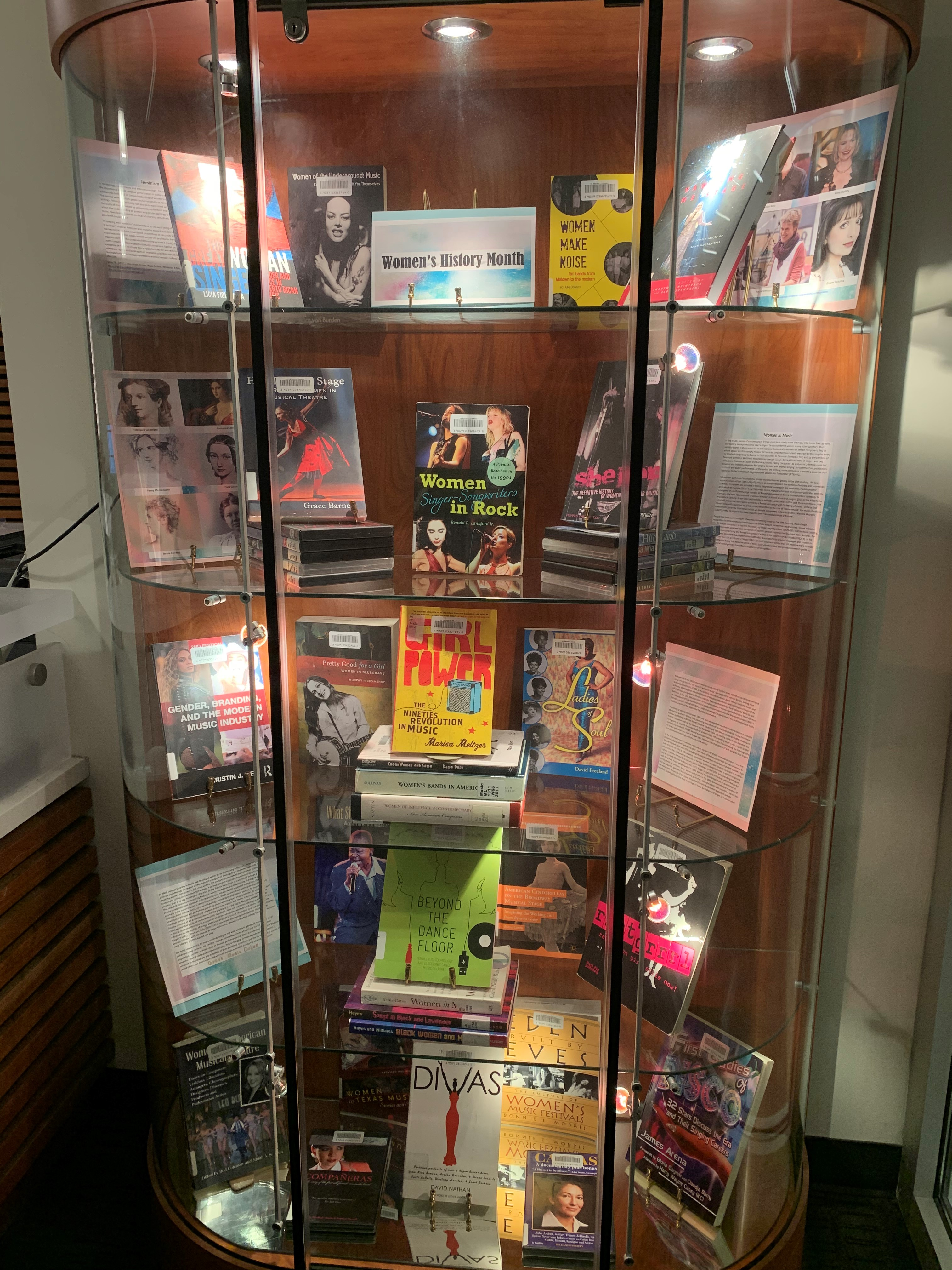DeVine Display Case featuring Women's History Month materials