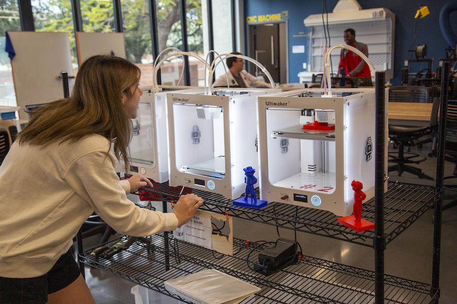 woman watching 3D printer print