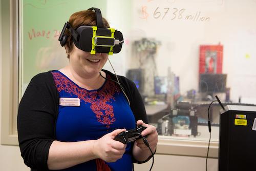 woman student wearing Oculus Rift VR headset