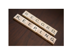 Record-keeping spelled out in board game tiles