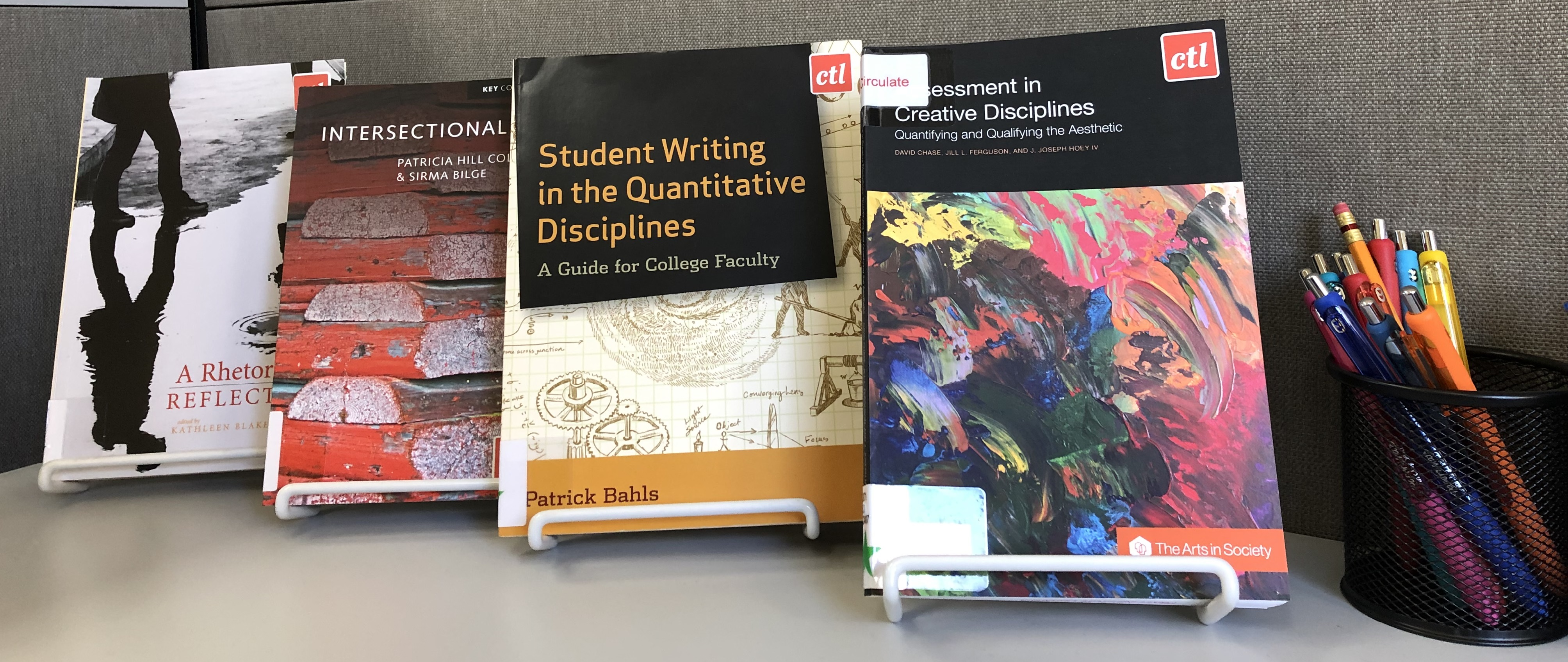An image of several books from the Teaching and Learning Center's Collection on display