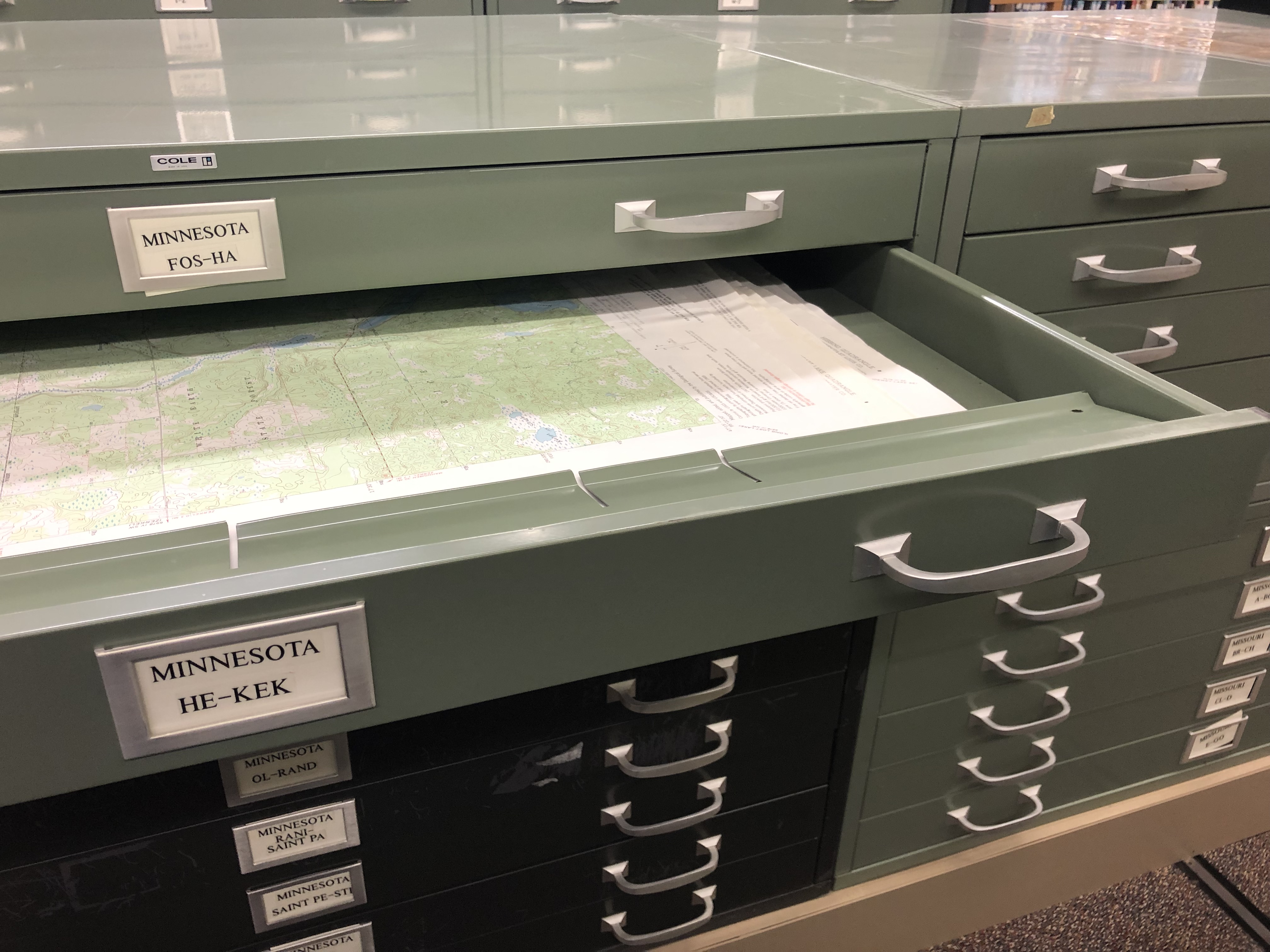 Open drawer showing map of Minnesota