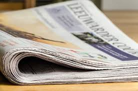 a folded newspaper on a table