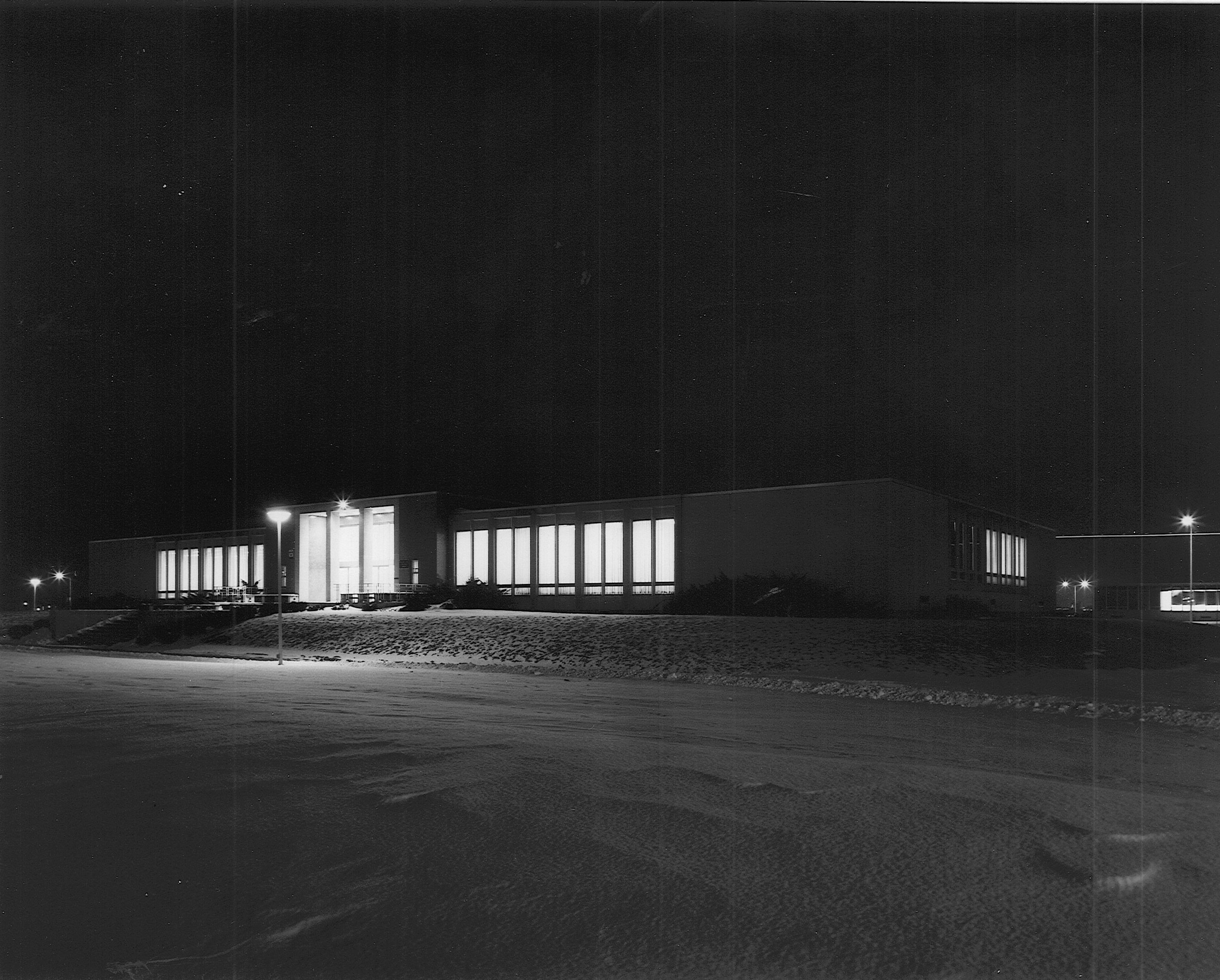 Nighttime photo of the library on North Campus.
