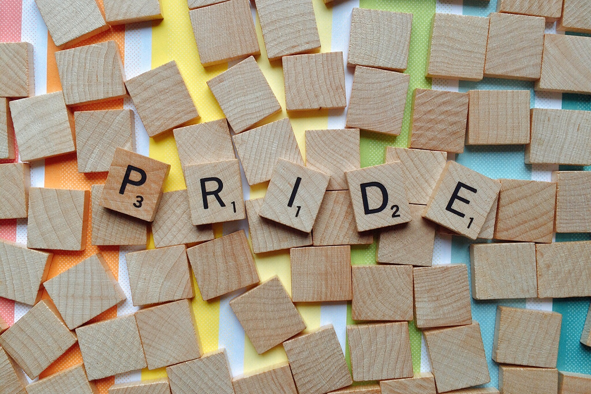 "image of ""Pride"" spelled out with Scrabble tiles"