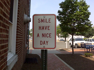 street sign that says smile have a nice day