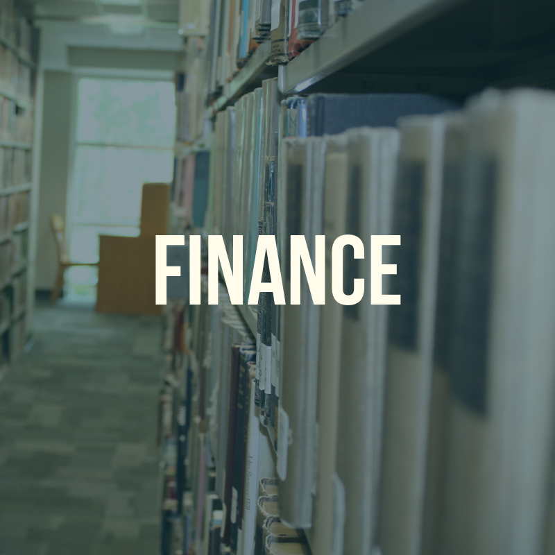 "Picture of the library shelves with the word ""Finance"" to label this guide."