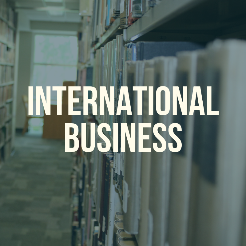 "Picture of the library shelves with the word ""International Business"" to label this guide."
