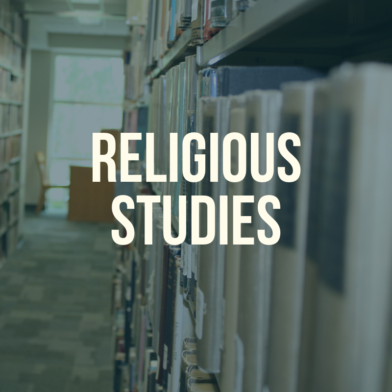 "Picture of the library shelves with the word ""Religious Studies"" to label this guide."