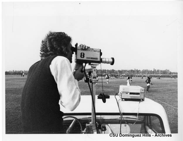 Camera man recording a Toros soccer match