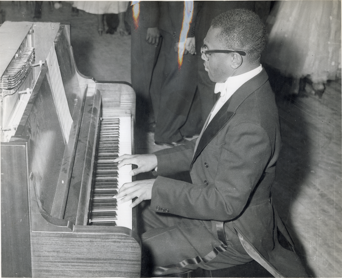 Don Lee White plays the piano at an event, circa 1960.