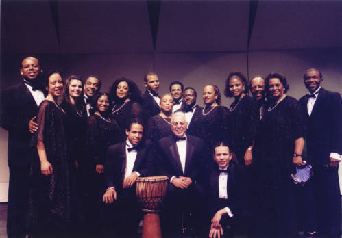 The Albert McNeil Jubilee Singers on their US Tour in 2002. Dr. McNeil sits at center.