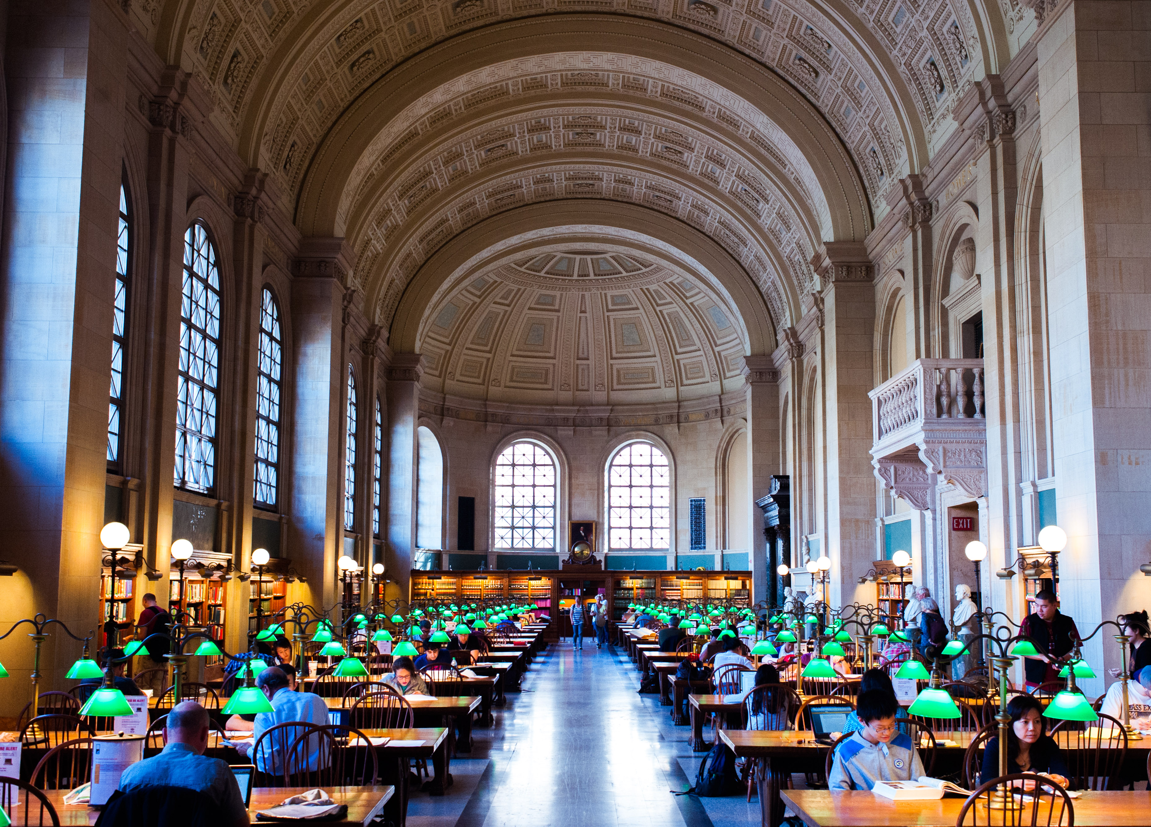 Photograph of the main reading room at the Boston Public Library.