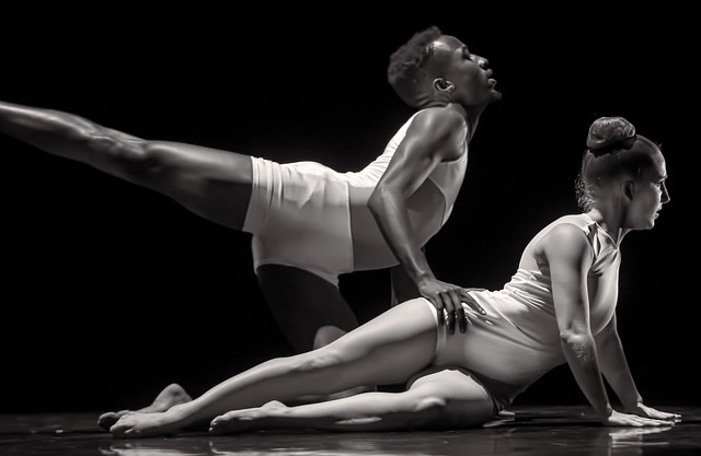 Photo of two dancers, one male, one female, during a performance.