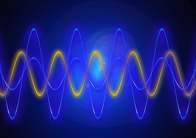 Image of various light waves in shades of blue and yellow.