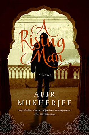 This is the cover of a rising man. It shows the outline of a man standing in an open door.