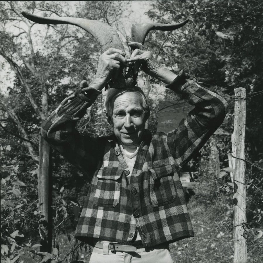 Harlan Hubbard holding antlers over his head; photo is by Guy Mendes