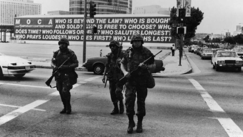 National Guardsmen cross the street near Barbara Kruger's mural on the fourth day of the Los Angeles riots in 1992.(Gary Leonard)
