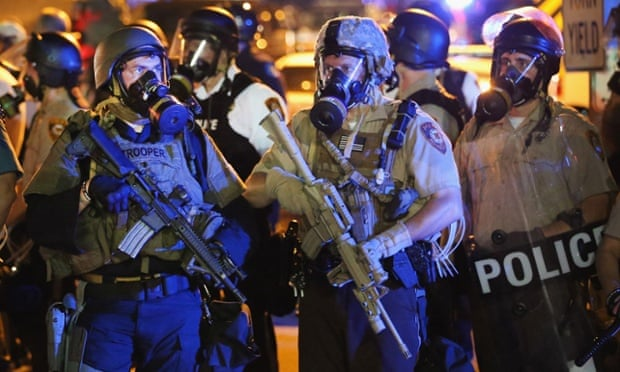 Police in Ferguson use a variety of crowd-control equipment including teargas following the killing of teenager Michael Brown in August. Photograph: Scott Olson/Getty Images