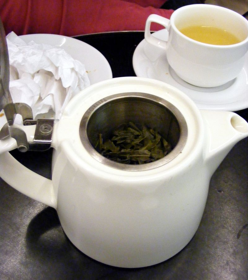Image of a teapot of green tea and teacup